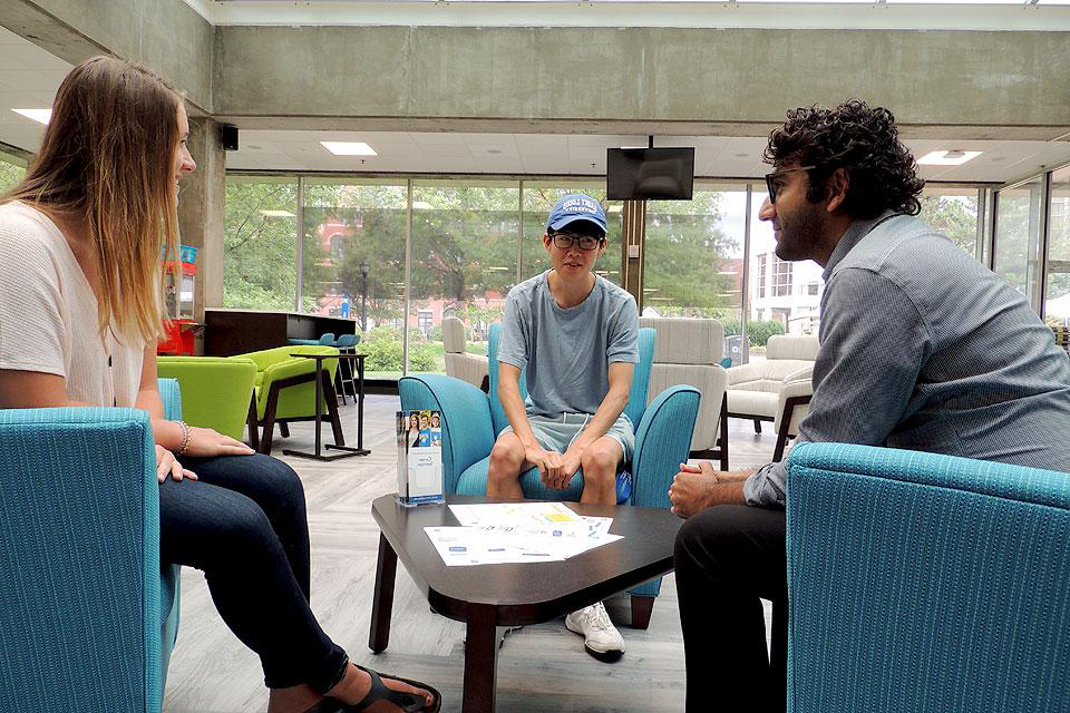 Career counselor Ahmar Ursani (left) meets with students, including student Career Ambassador Lizzie Twardock (right) and junior  Steven Kim (center) in the new Career Services Center.