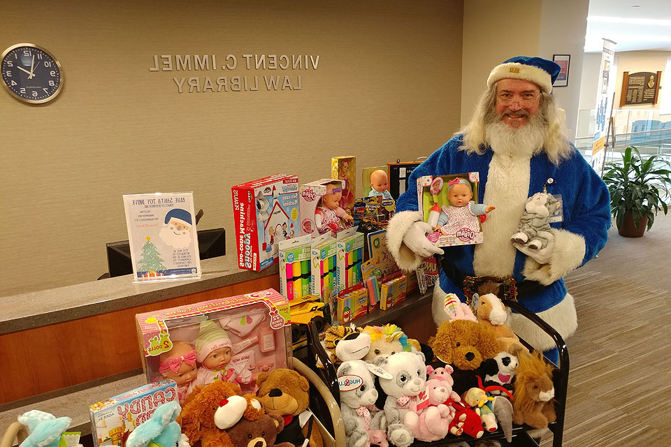 Blue Santa collects toys at the Law Library