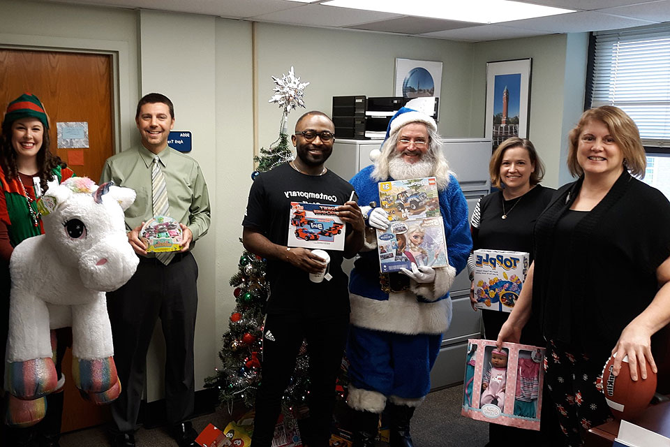 Blue Santa collects donated toys