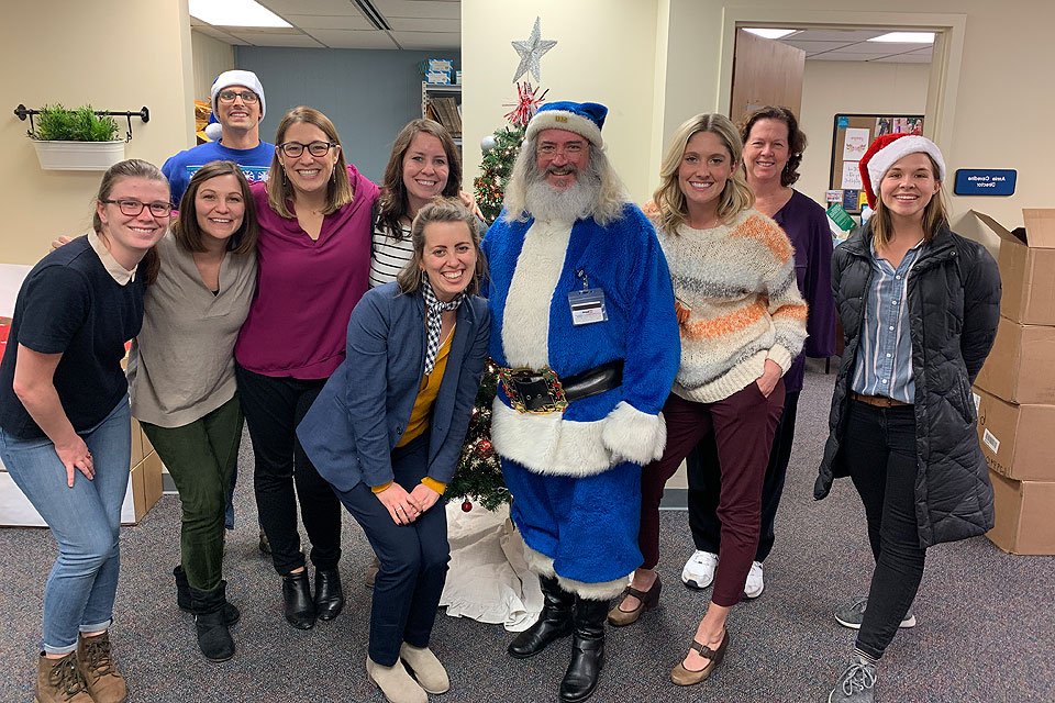 Blue Santa stops for a photo