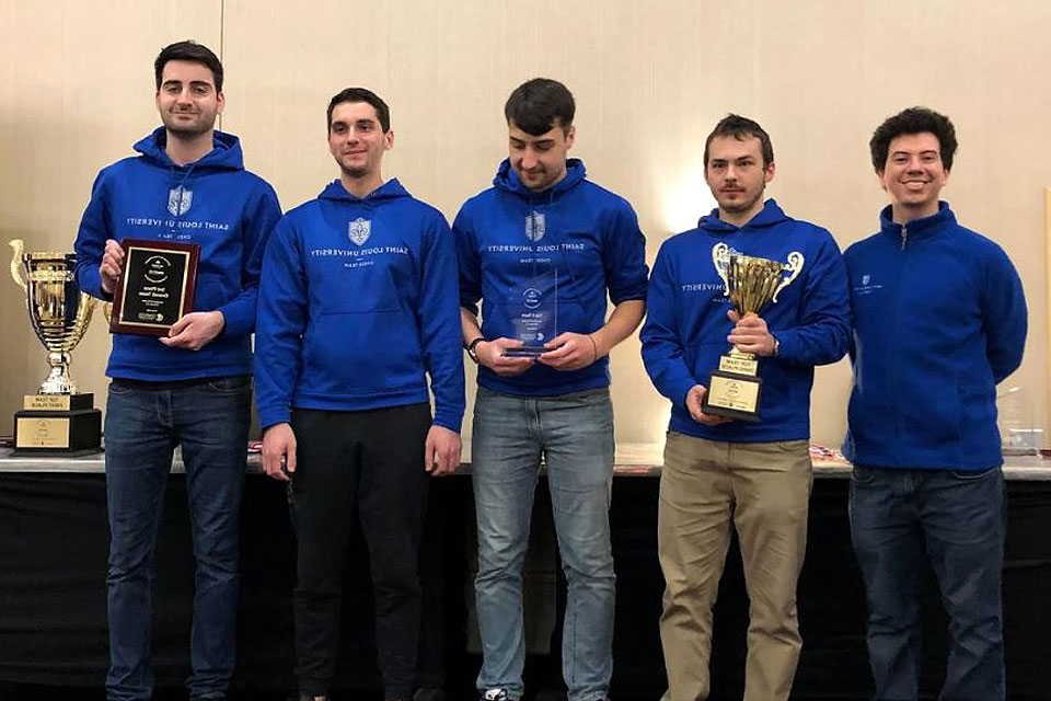 SLU's chess team poses with their trophy after placing third at the 2019 Pan-American Intercollegiate Chess Championships.
