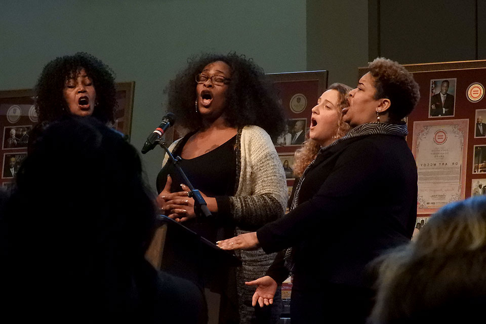 Members of the St. Louis Community Ensemble sing.