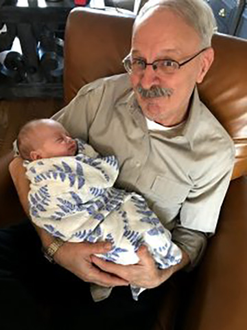 Officer Bob Petersen with his grandson, Jack.
